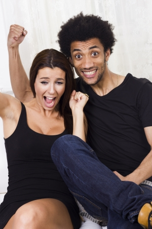 Cheerful happy interracial couple at home photo