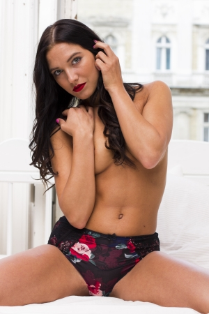 Sexy beautiful brunette topless woman on the bed photo
