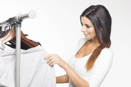 Beautiful woman buying clothes photo