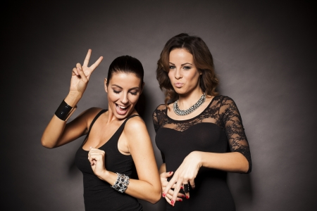 Two beautiful women having a party Stock Photo - 23157979