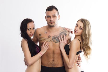 seks: Sexy trio swinger na białym tle pojedyncze