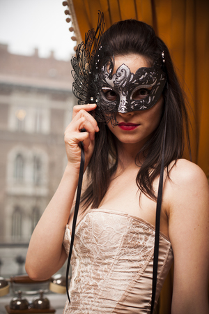Sexy vintage woman in venetian mask photo