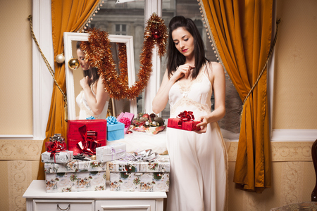 Sexy vintage woman with christmas presents photo