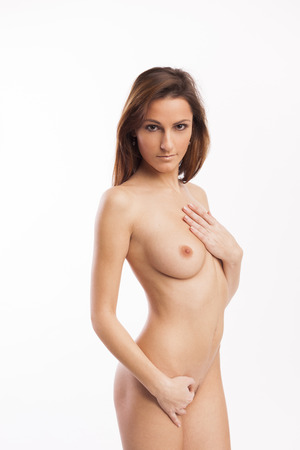 Beautiful nude brunette on white