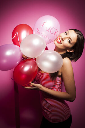 Beautiful cheerful woman with valentines day balloon