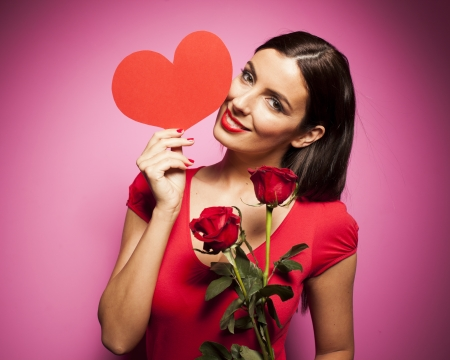 Sexy woman with valentines day balloon on pink background photo