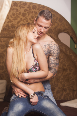 Sexy passionate heterosexual couple embracing on the bed  photo