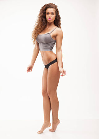 Beautiful sexy perfect fitness woman on white isolated  photo