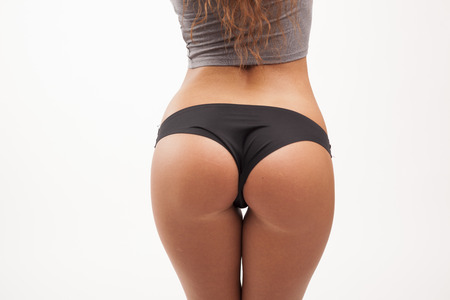Perfect female ass on white isolated  Stock Photo