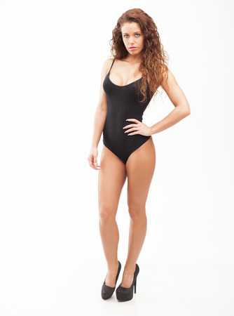 Sexy perfect brunette woman in black body on white isolated