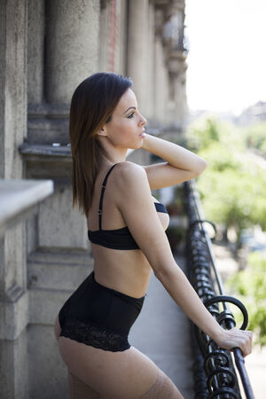 Beautiful sexy lingerie woman on the balcony