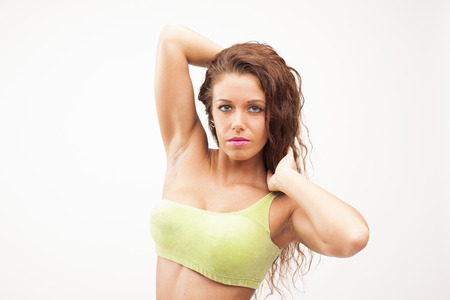 Beautiful sexy perfect fitness woman on white isolated background