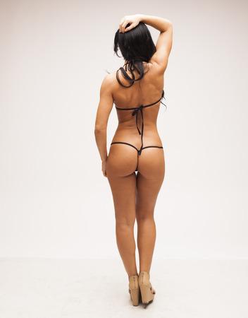 oiled: Sexy woman with perfect body in micro bikini