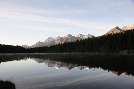 sunrise reflection on Herbert Lake in Alberta Canada Stock Photo