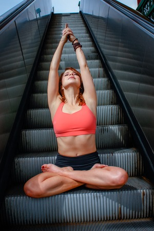 An urban Yogi meditates and practices yoga in the city