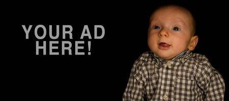 A 4 Month Old Baby Poses on a Black Background. Perfect for Memes with Copy Space.