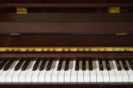 piano closeup: Wooden vintage piano closeup