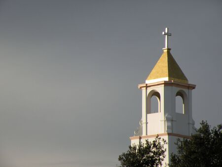 Church steeple among the clouds