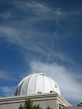 An onservatory dome against a blue sky