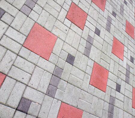 red squared bricks with grey rectangular shaped bricks