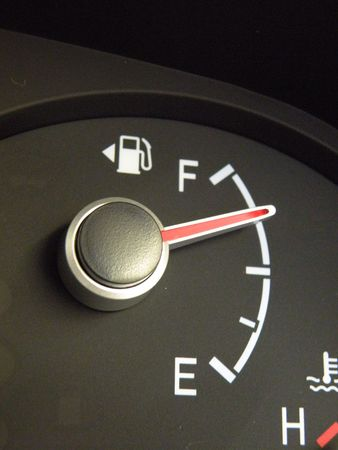 An automobile fuel gauge reading three quarters full on a tank of gas
