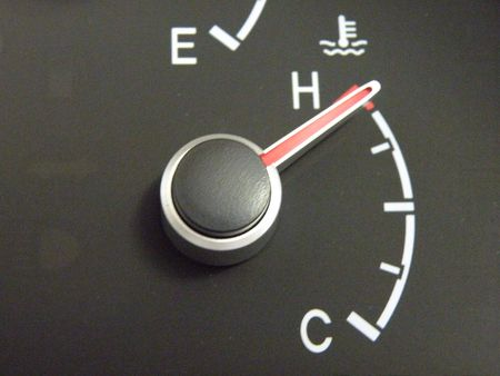 An auotomobile coolant temperature gauge reading fully hot, or overheating