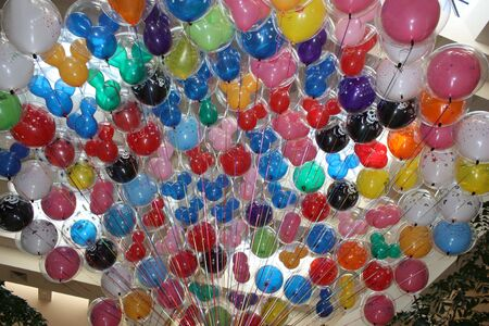 Helium filled baloons on their strings