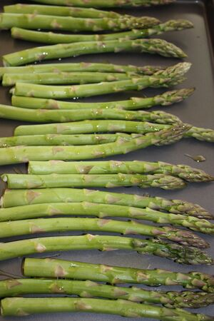 Asparagus on a baking sheet prior to being roasted 写真素材