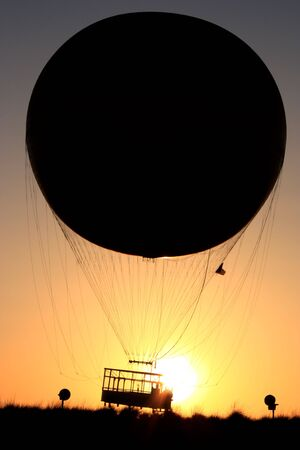 A helium filled balloon which goes up 400 feet for passengers to view the surrounding are in Irvine CA. 写真素材