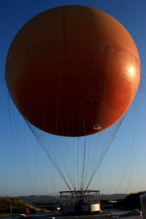 A helium filled balloon which goes up 400 feet for passengers to view the surrounding are in Irvine CA. Stock Photo - 5116790