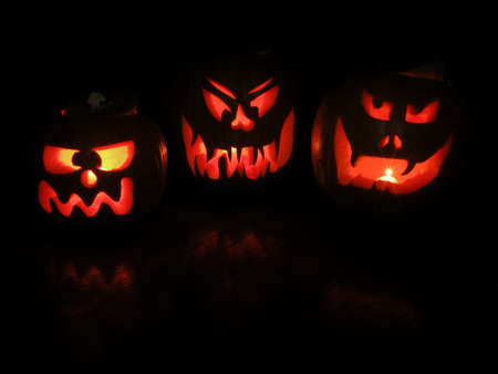 jack-o-lanterns with candles glowing inside of them Stock Photo