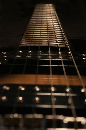 looking down the strings of an electric guitar