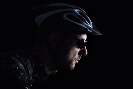 Dark portrait of a cyclist