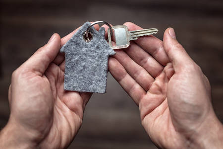 Latchkey in both hands Stock Photo