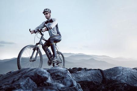 Mountain biker reaching the summit