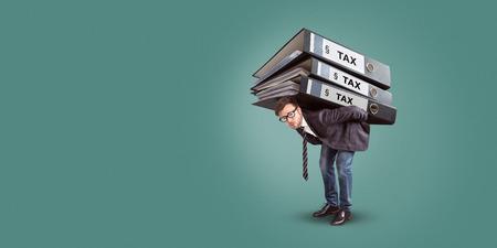 Man carrying a giant stack of tax folders Standard-Bild