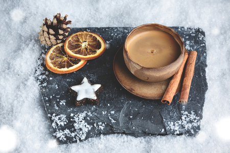 Espresso cup with winter decoration and snow