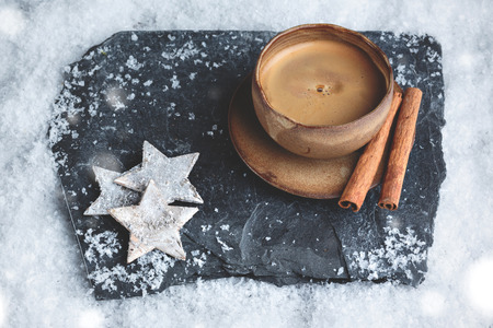 Stylish espresso cup with winter decoration on snow Stock Photo