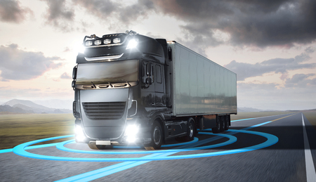 Truck with visualized sensor graphics driving on a highway