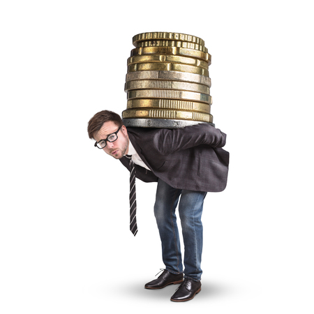 Businessman carrying a giant stack of coins on his back