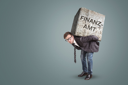 Businessman bending under a heavy stone with the German word ? ? | Finanzamt? ?? printed on it. Translation on stone: Tax Office