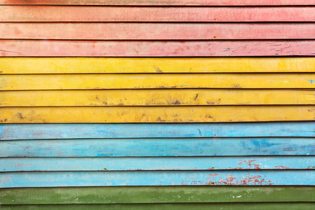 Old colorful wall made of wooden boards
