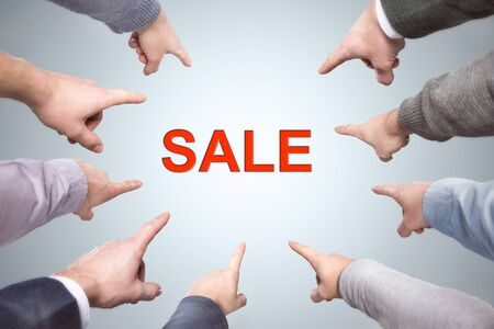 Many fingers point to the word SALE Zdjęcie Seryjne