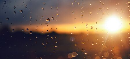 Raindrops on a windowpane at sunset panorama Zdjęcie Seryjne