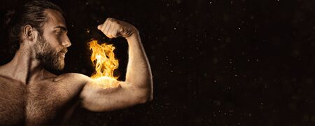 Strong man with a biceps on fire - Panorama