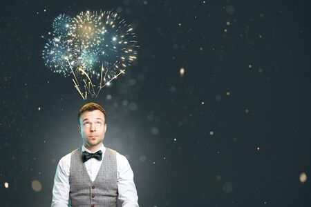 Portrait of a man with fireworks over the head