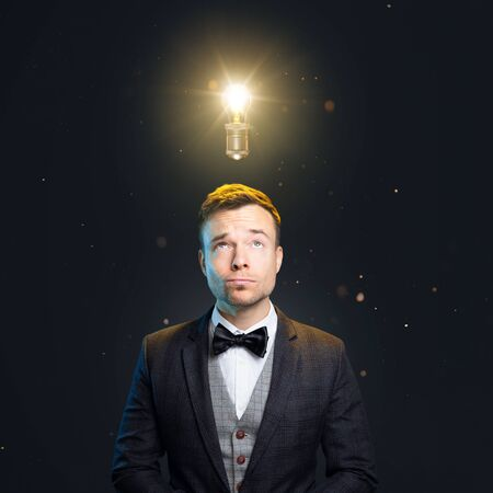 Well-dressed man with a light bulb above the head