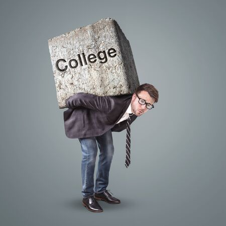 Man carrying a heavy stone marked with College
