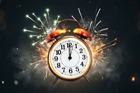 12 o'clock on a retro clock in front of fireworks
