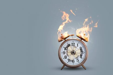 Alarm clock on fire with actual flame